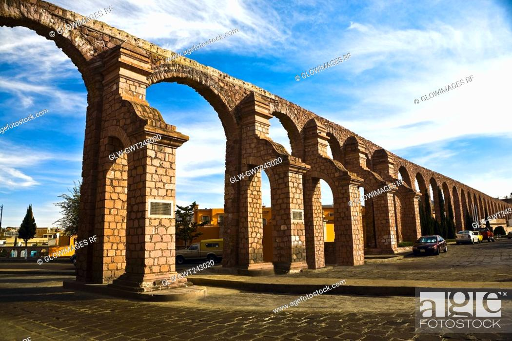 Stock Photo: Cars parked near an aqueduct, Zacatecas State, Mexico.