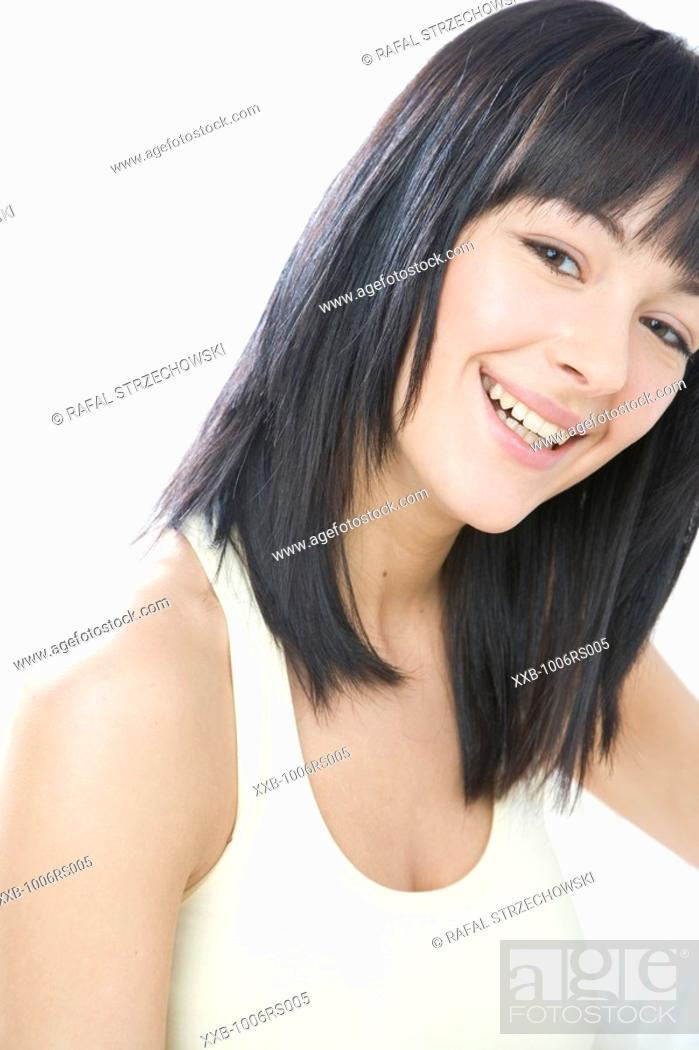 Stock Photo: portrait of a smilling brunette.