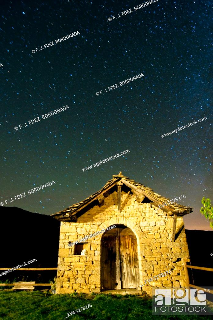 Stock Photo: Asín de Broto typical agriculture house with stars at background  Long exposure  Huesca  Aragon  Spain.