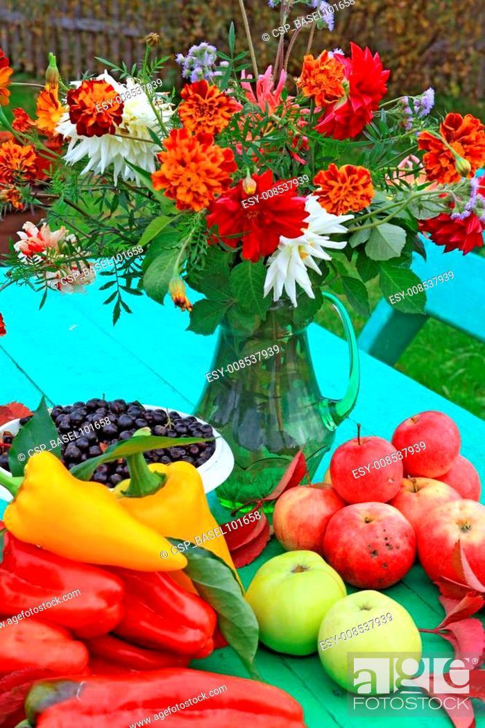 Stock Photo: autumn still life on green table.