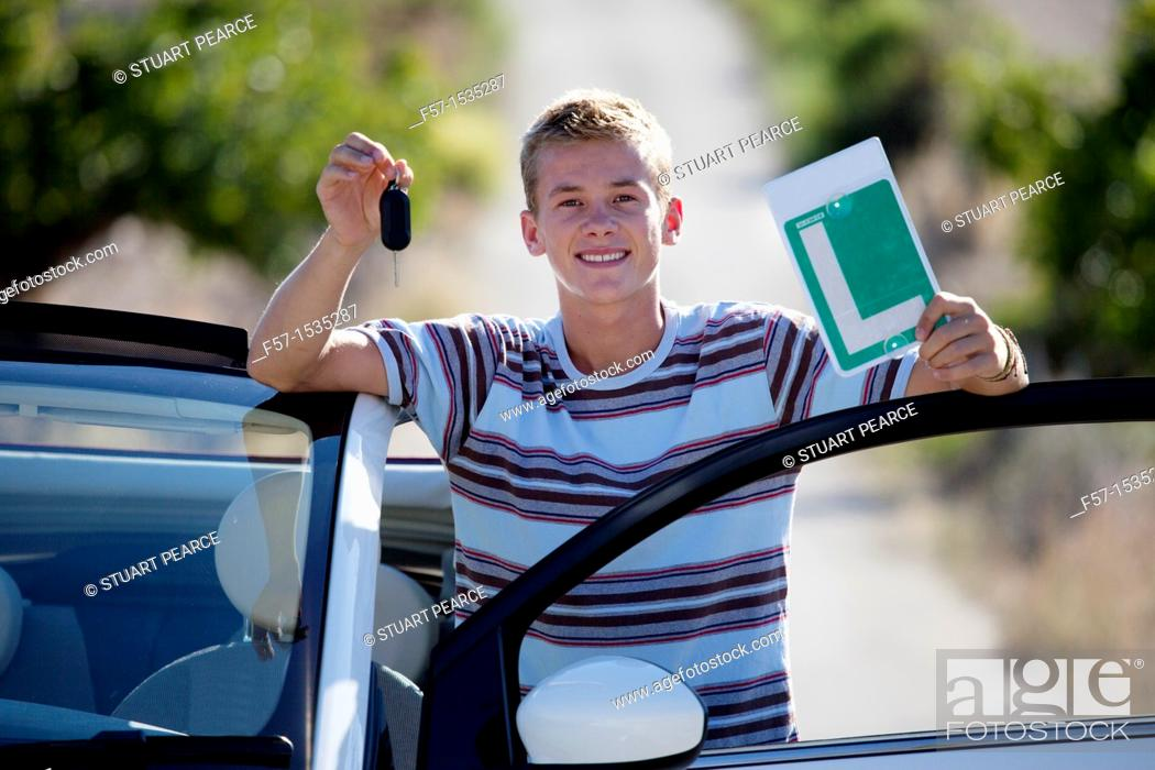 Stock Photo: Young male learner driver.