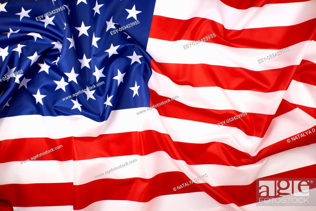 Stock Photo: national textile flag of United States of America, surface in waves. Independence Day Background.