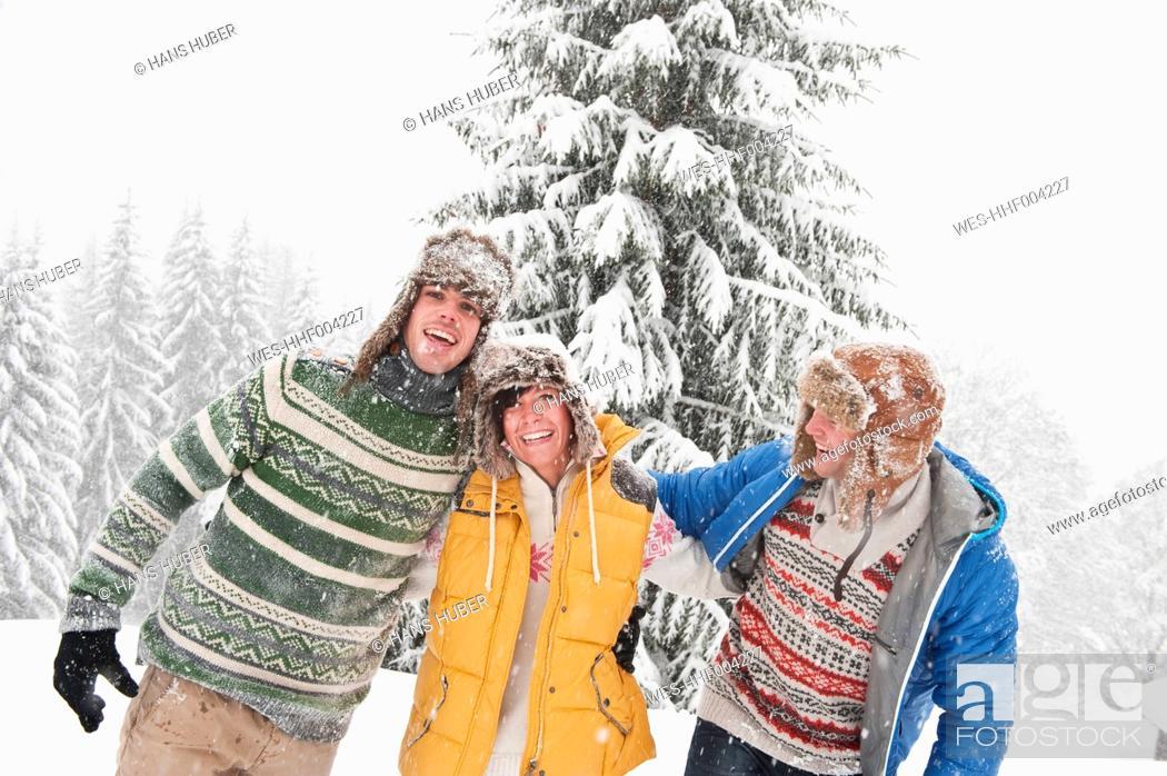 Stock Photo: Austria, Salzburg, Men and woman in winter, smiling.