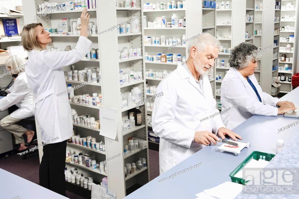 Stock Photo: Pharmacists filling prescriptions.