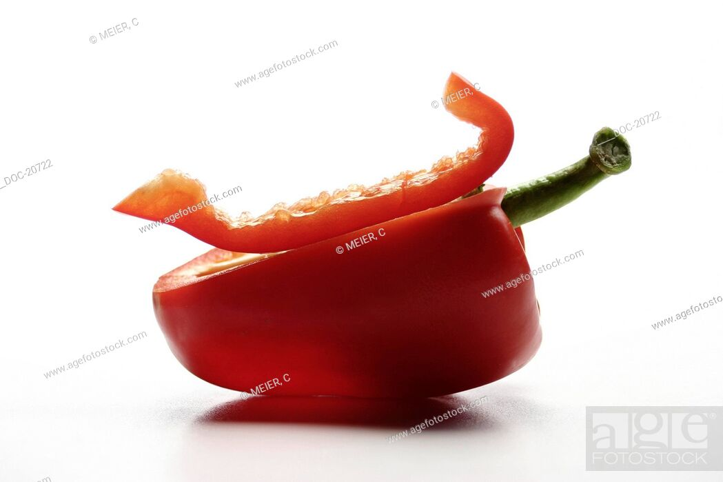 Imagen: half of a red pepper on white surface area.