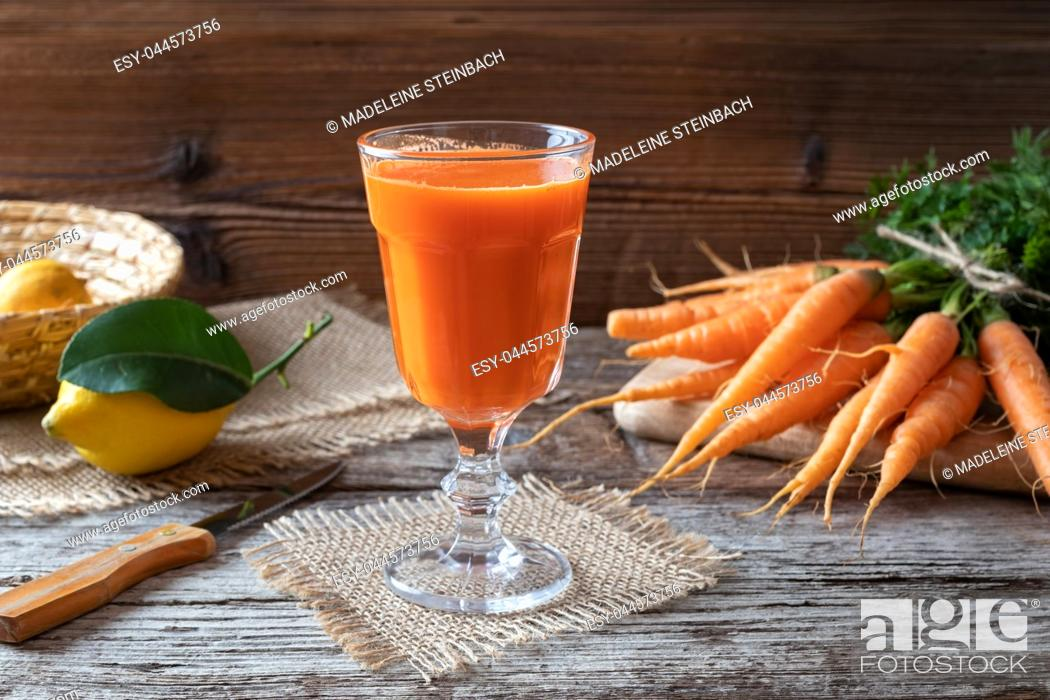 Stock Photo: A glass of fresh carrot juice.