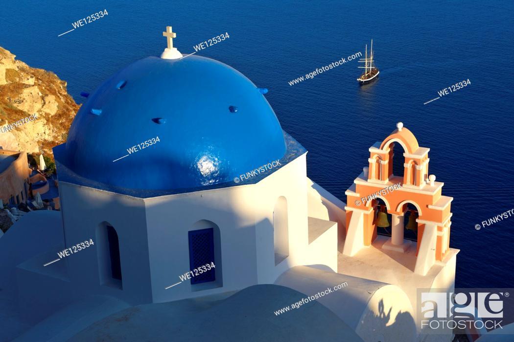Stock Photo: Oia, ( Ia ) Santorini - Blue domed Byzantine Orthodox churches, - Greek Cyclades islands.