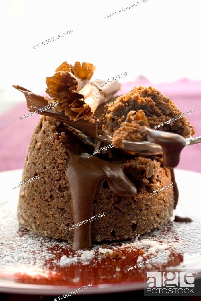Stock Photo: Chocolate soufflé filled with chocolate sauce.