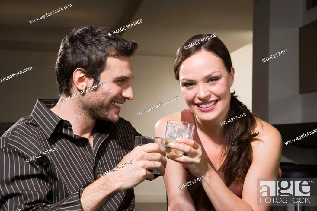 Stock Photo: Couple drinking cocktails.