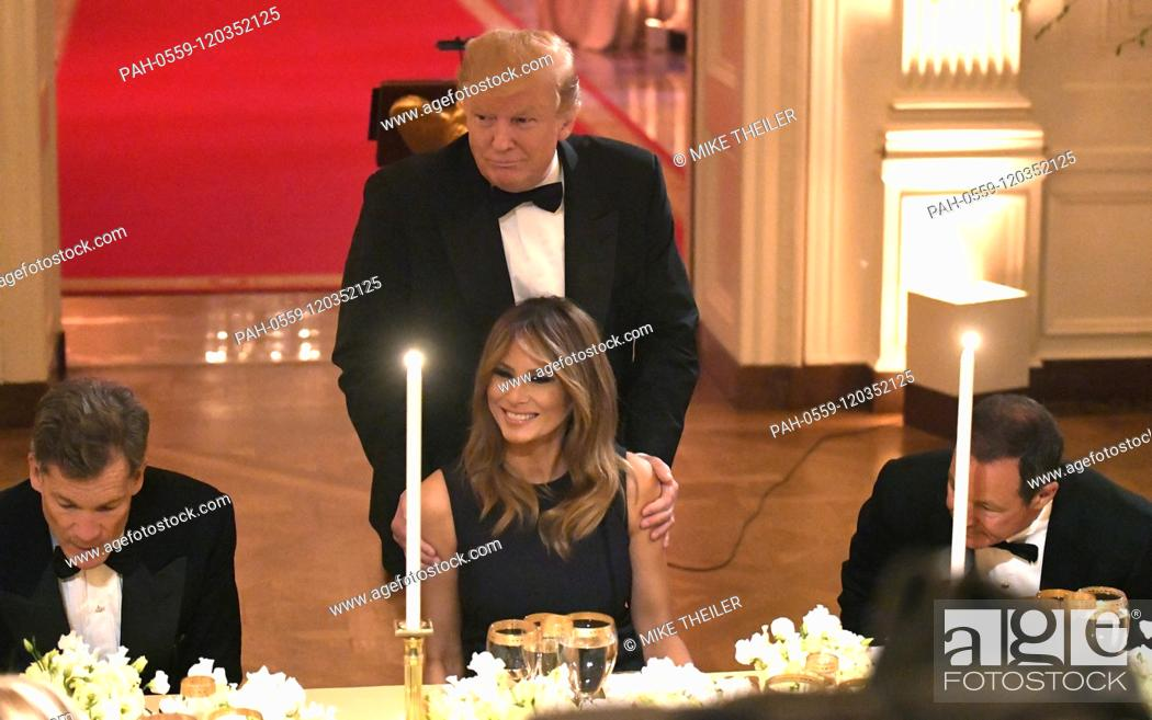 Stock Photo: United States President Donald J. Trump shows First Lady Melania Trump to her seat as they attend a White House Historical Association dinner at the White House.