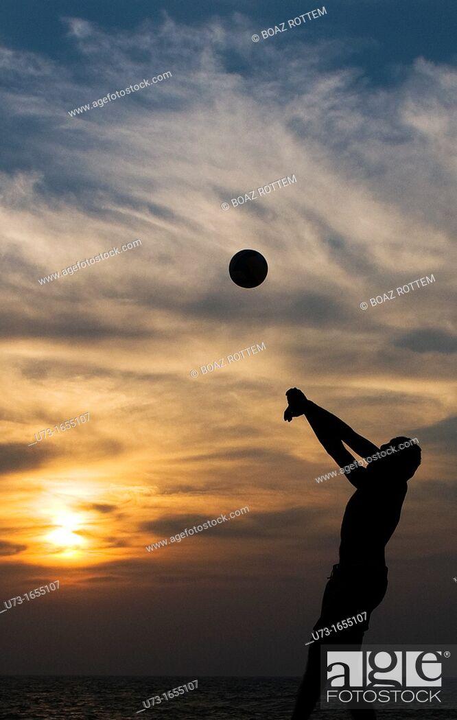 Stock Photo: Beach volleyball during sunset on Negombo beach, Sri Lanka.