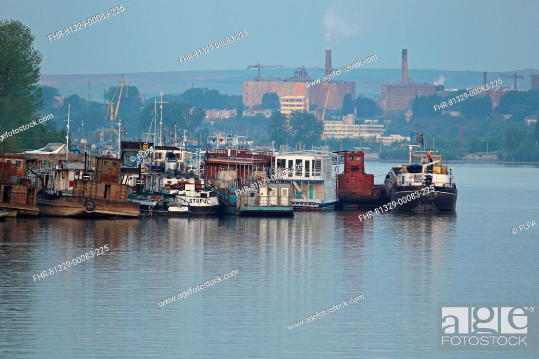 Stock Photo: Barges and tourist pontoon boats moored together on river, Tulcea, River Danube, Danube Delta, Dobrogea, Romania, may.
