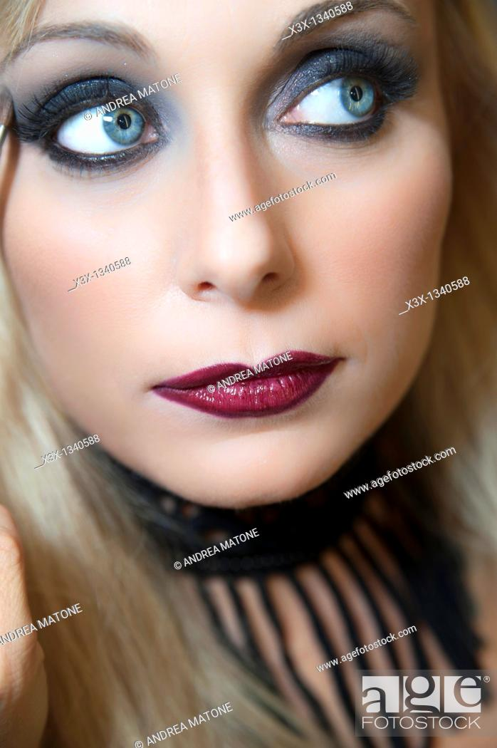 Stock Photo: Woman model with makeup looking away.