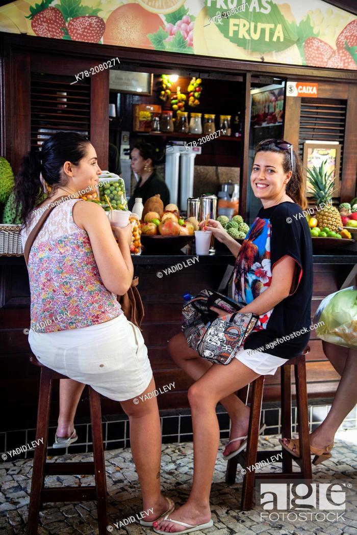 Stock Photo: Women sitting at a Juice stand, Fortaleza, Brazil.