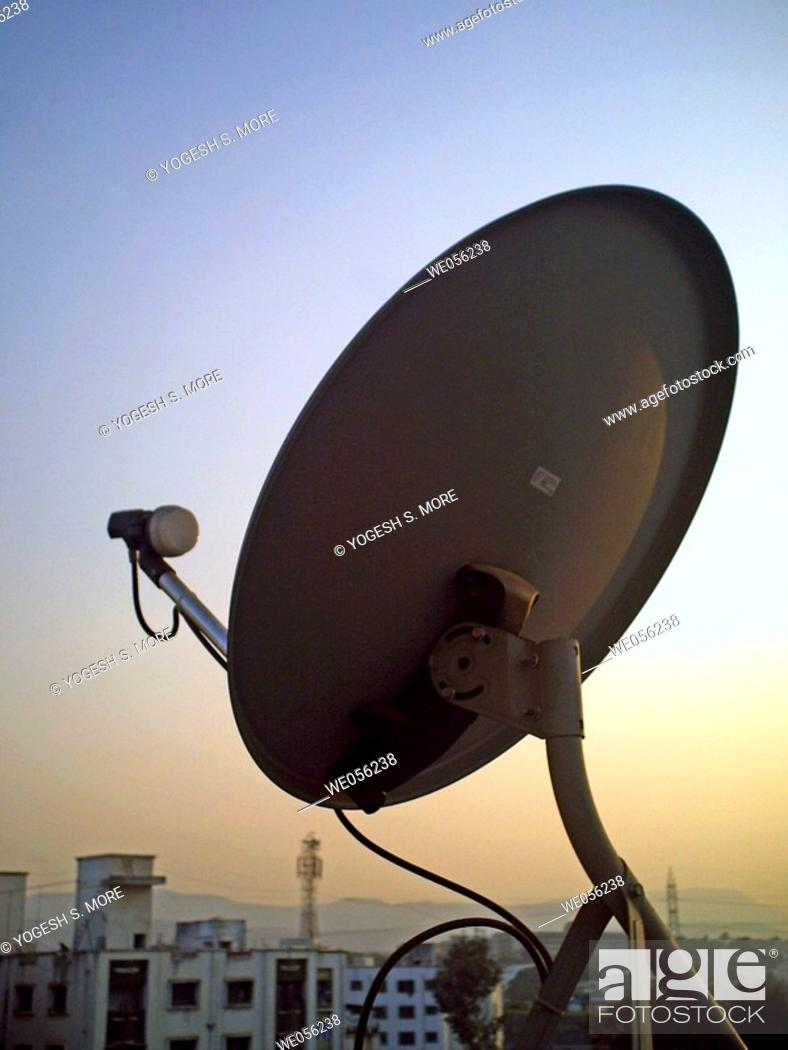 Stock Photo: A dish antena of a television set on a building terrace  Pune, Maharashtra, India.