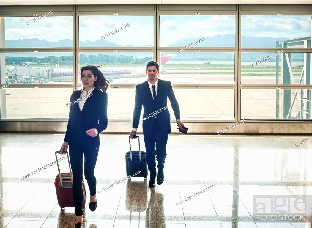 Stock Photo: Businesspeople running in airport.