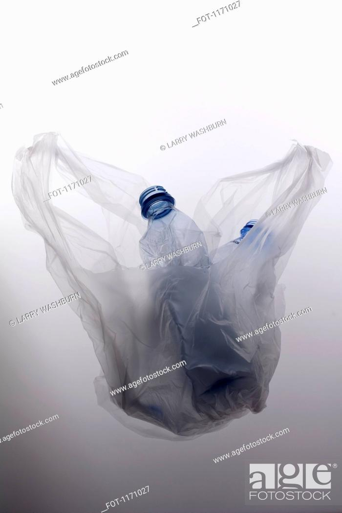 Stock Photo: A plastic bag with two empty plastic water bottles.