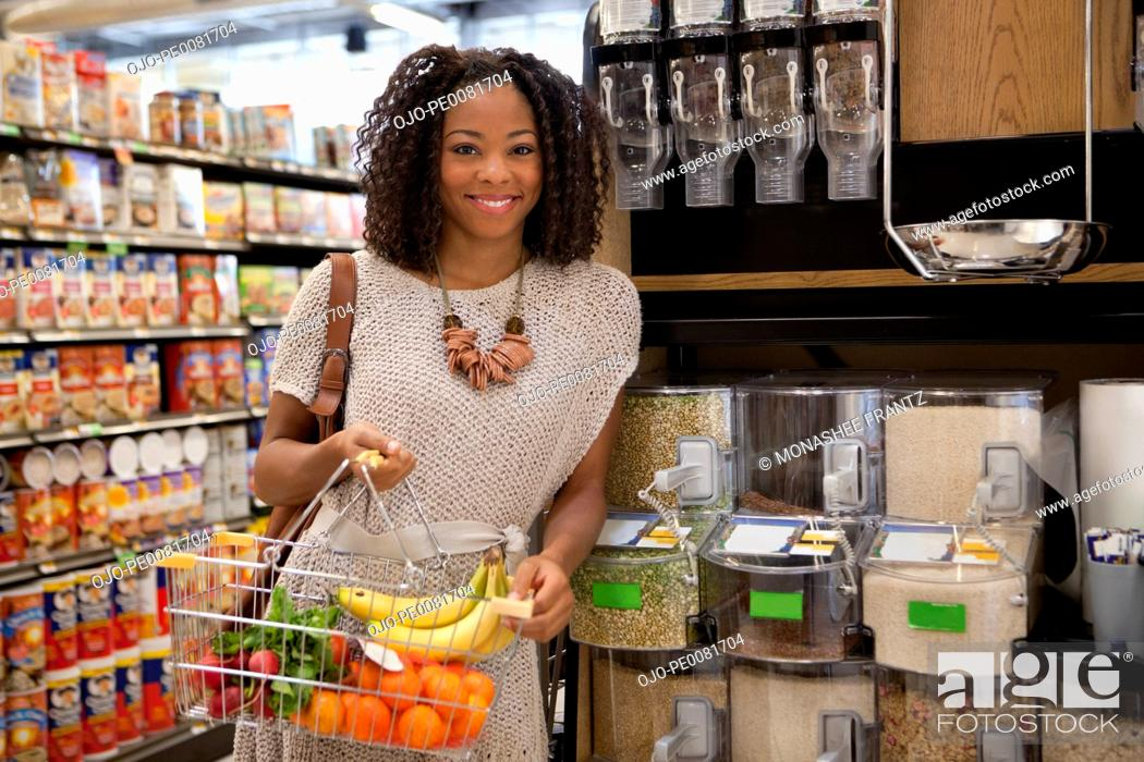 Stock Photo: Woman shopping in supermarket.