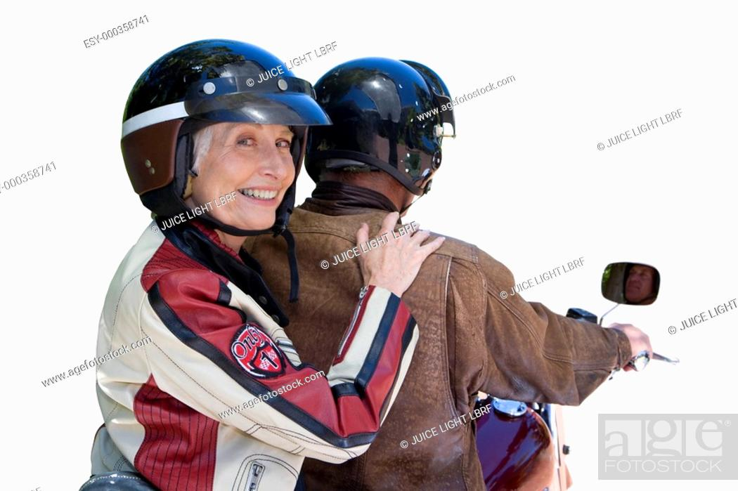 Stock Photo: senior couple on motorcycle, cut out.
