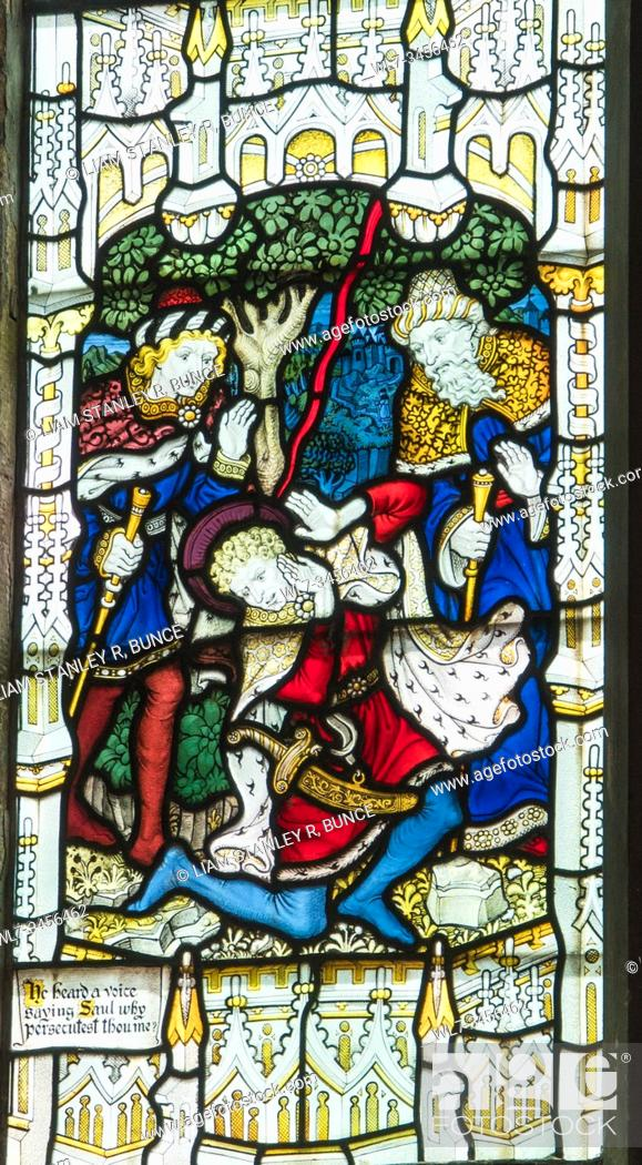 Stock Photo: Stained glass depicting Saul falling to the ground as he nears Damascus, St Mary's Priory Church, Abergavenny Wales UK. May 2019.