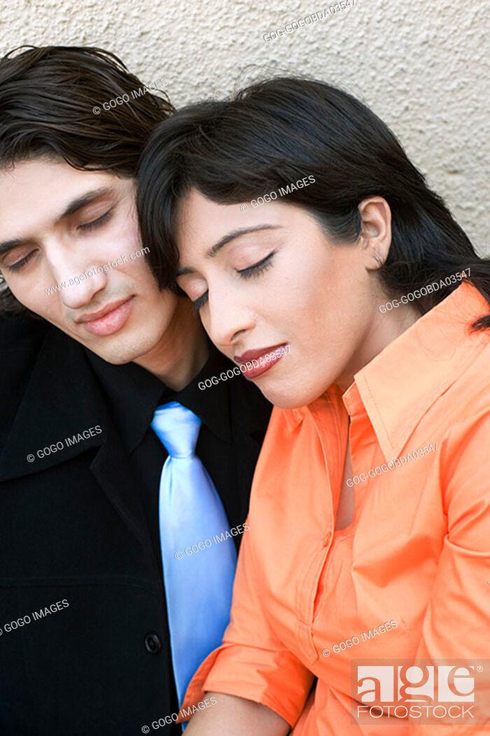 Stock Photo: Woman sleeping on boyfriend's lap.