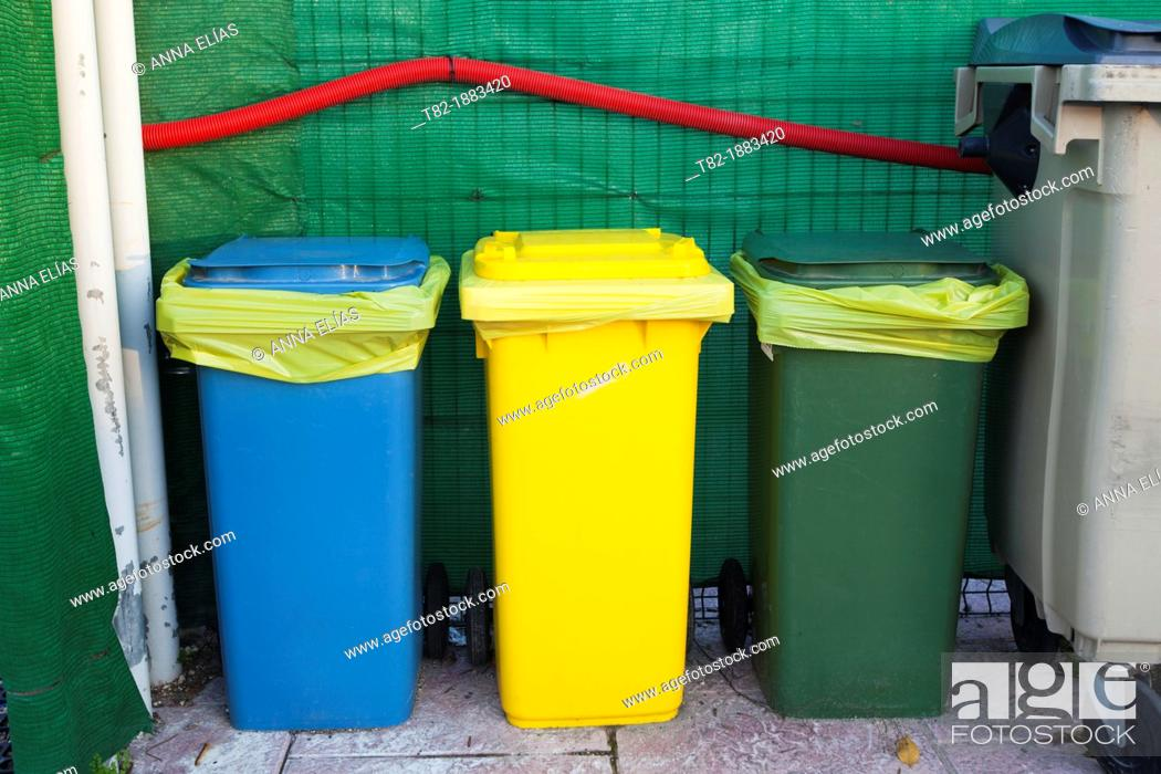 Stock Photo: three dumpsters for recycling selective colors, Sevilla, Spain.