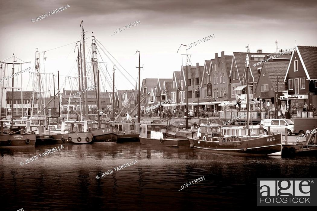 Stock Photo: Boats and houses in a Holland port  Volendam, Waterland municipality, North Holland province, Holland, Netherlands, Europe.