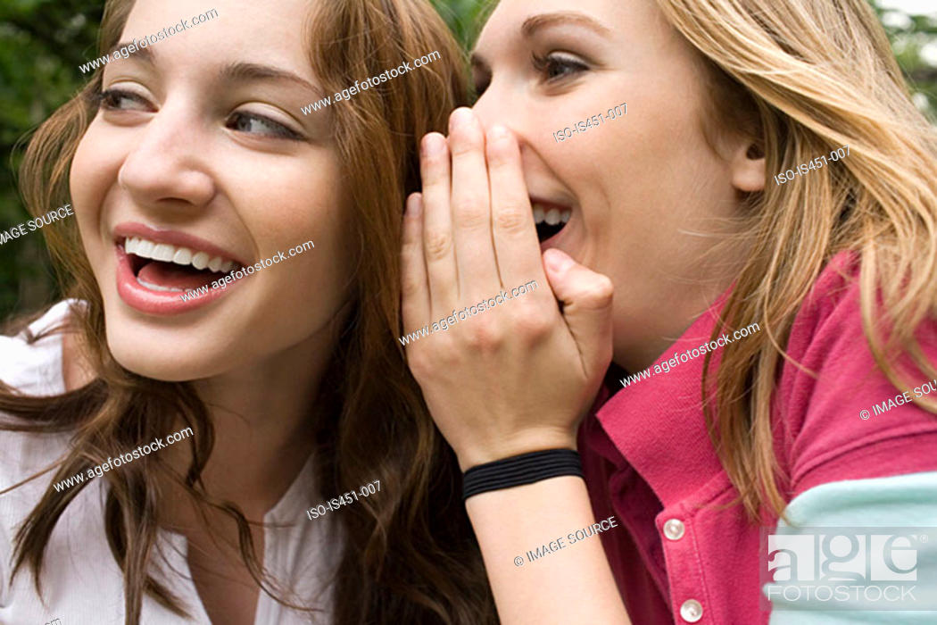 Stock Photo: Two teenage girls gossiping.
