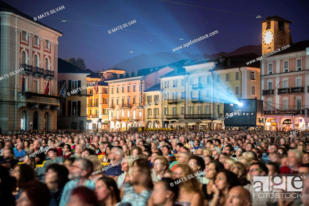 Stock Photo: Film Festival Locarno with crowd and projector on piazza Grande in Ticino, Switzerland.