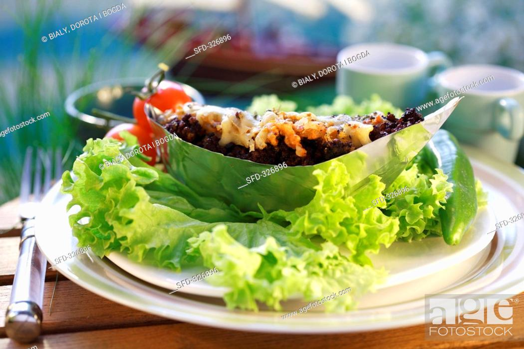 Stock Photo: Grützwurst black pudding in aluminium boat with ajvar.