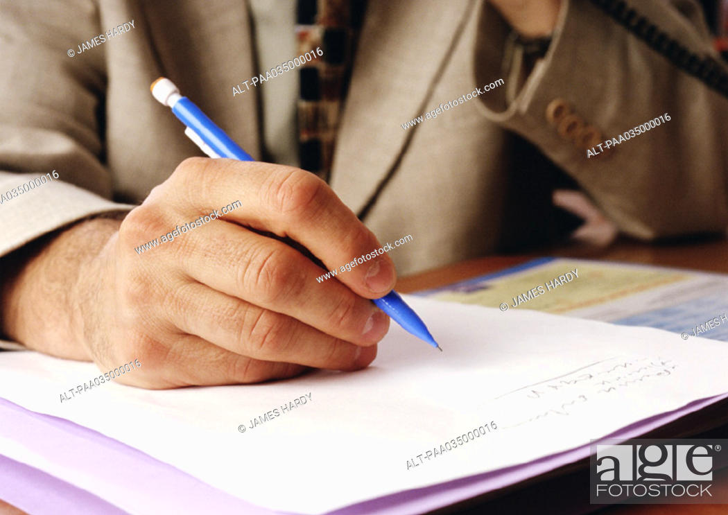 Stock Photo: Person writing, close-up on hand.
