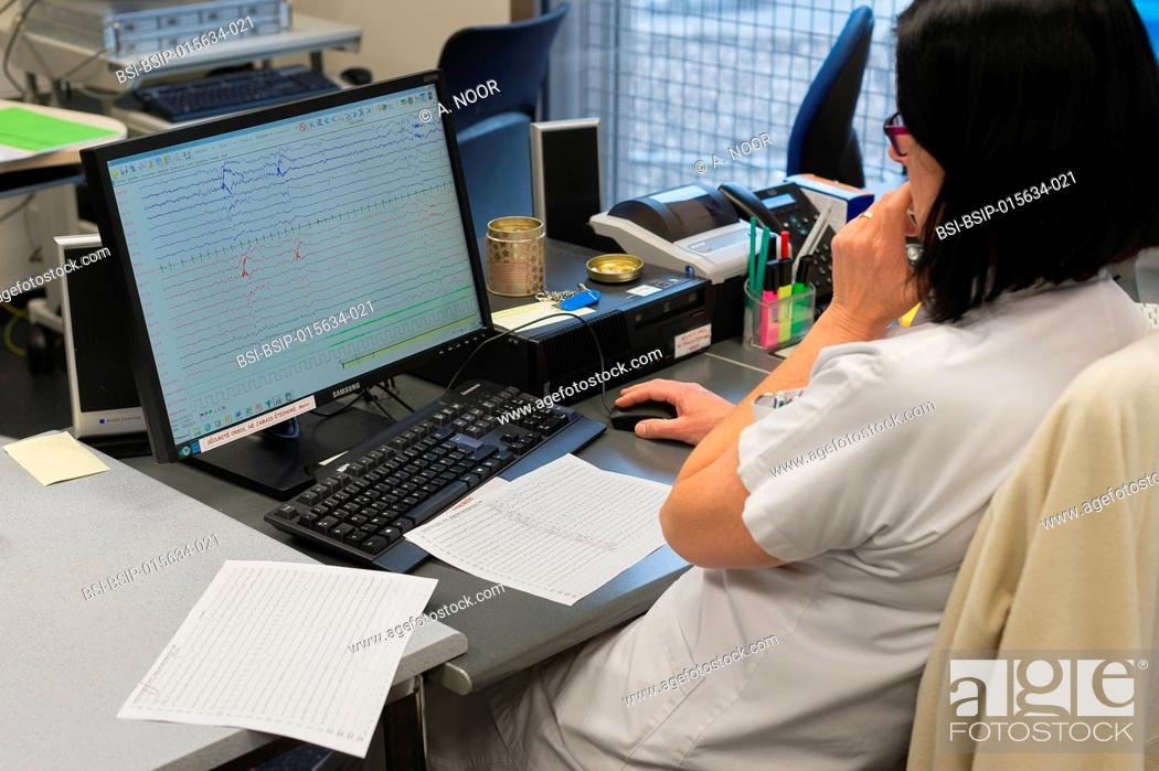 Stock Photo: Reportage in the epileptology unit in Nice Hospital, France. A nurse in the control room. The control room is used during long-term EEGs.