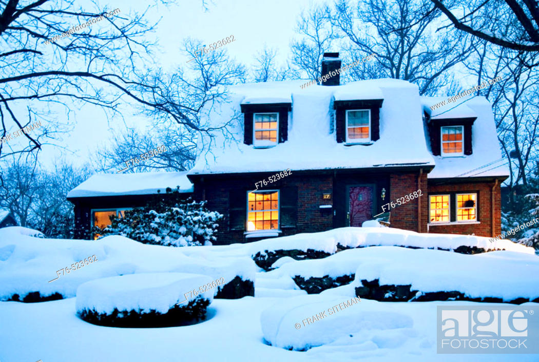 Stock Photo: Suburban home at dusk immediately after snowstorm. Boston. Massachusetts. USA.