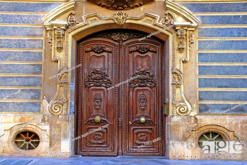 Stock Photo: side door of the Palau del Marquès de Dosaigües, Baroque and Rococo civil building, home of the Museum of Ceramics, Valencia, Spain.