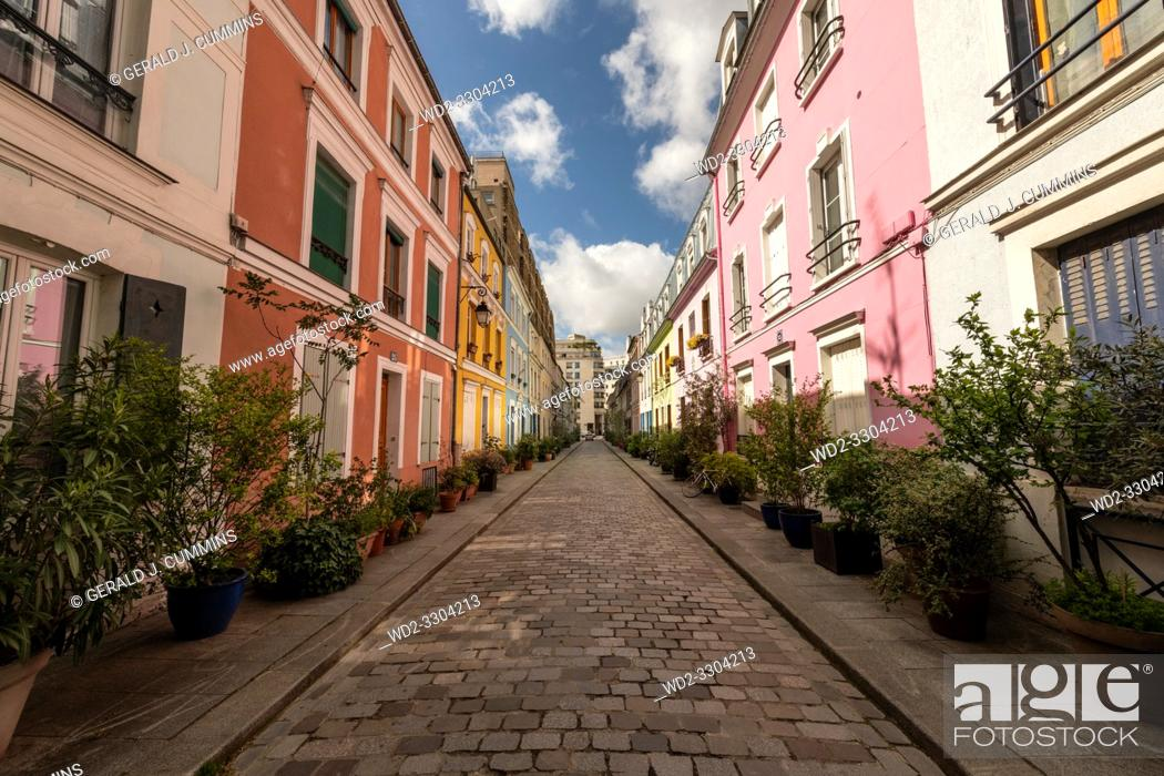 Stock Photo: Rue Crémieux is hidden between Rue de Lyon and Rue de Bercy, and can be quickly missed. . Most of the houses are painted in a variety of pastel colours.