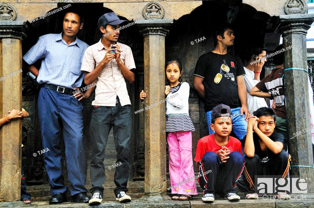 Stock Photo: On the day of Gai Jatra festival in August at Durbar square  Spectator watching the parade of the festival.