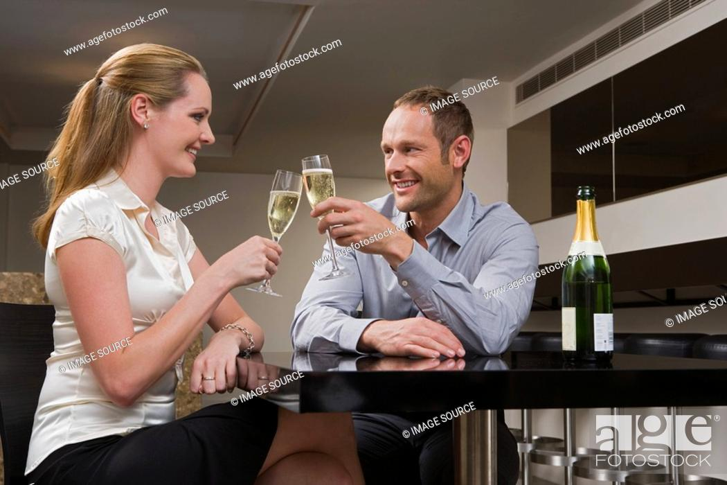 Stock Photo: Couple drinking champagne in a bar.