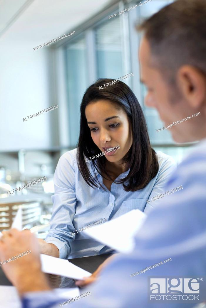 Stock Photo: Businesswoman discussing work with colleague.