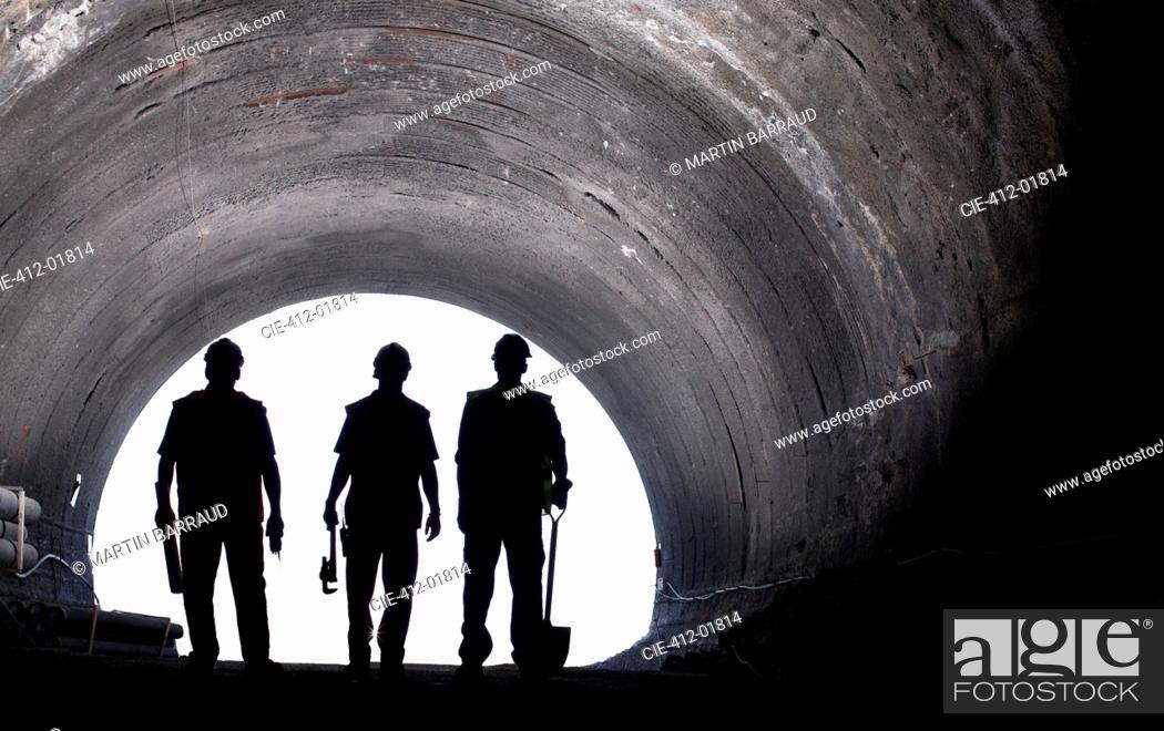Stock Photo: Silhouette of workers in tunnel.