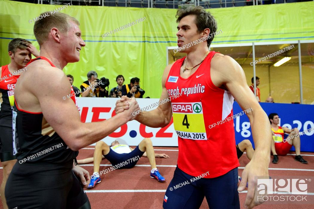 Stock Photo: Arthur Abele of Germany, left, and Adam Sebastian Helcelet of Czech Republic pictured after the 1000m of the men's heptathlon during the European Athletics.