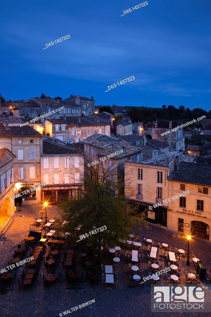 Stock Photo: France, Aquitaine Region, Gironde Department, St-Emilion, wine town, elevated view of Place de l'Eglise Monolithe, dusk.