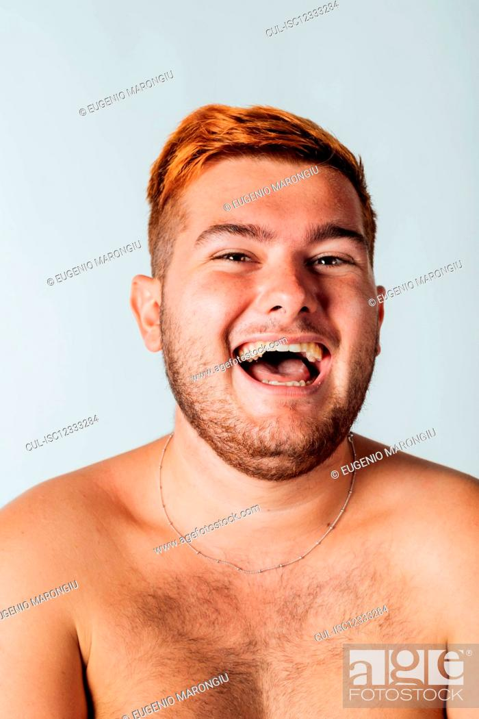 Stock Photo: Portrait of a young man with bare chest, laughing.
