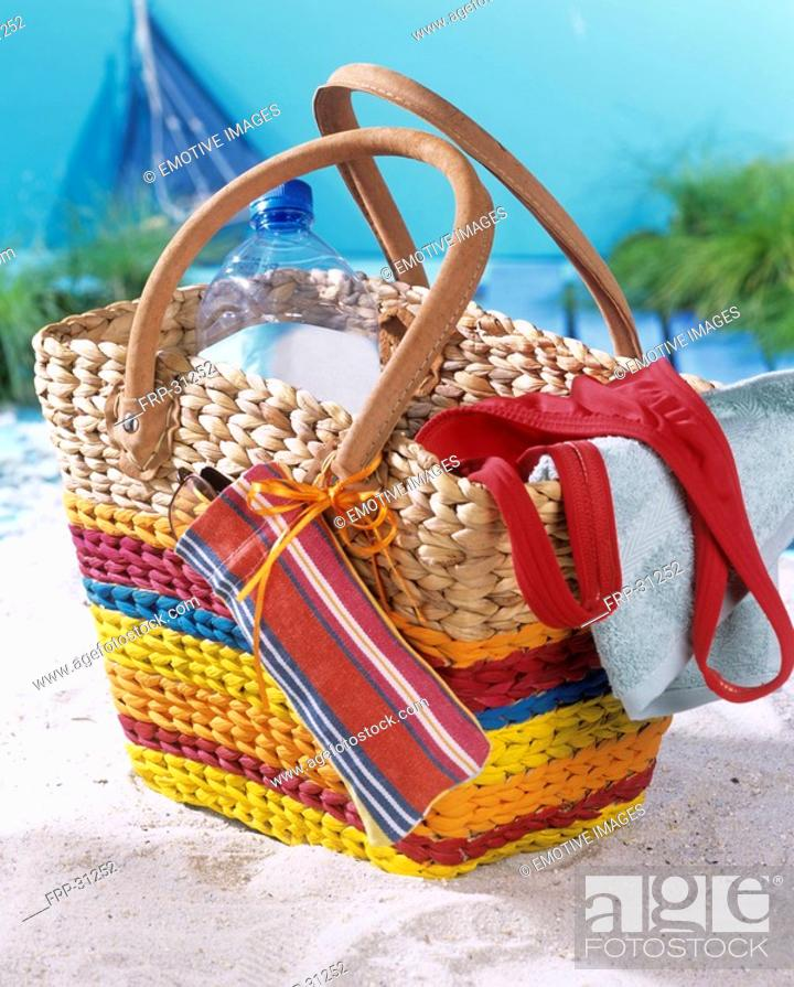Stock Photo: Beach bag with stripes and small mobile phone or spectacle case.