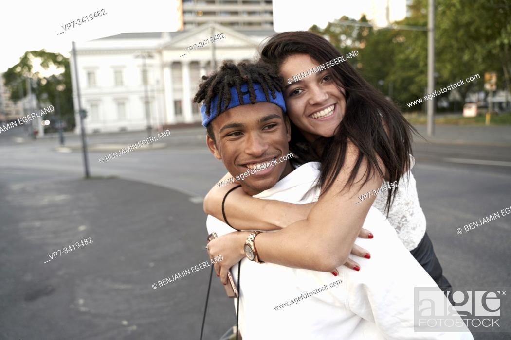 Stock Photo: Young couple piggybacking. Frankfurt am Main, Germany.