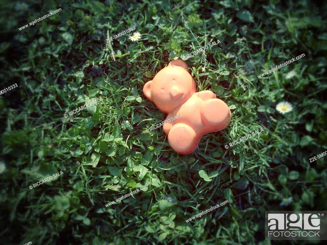 Stock Photo: Toy Bear Lying in the Grass.