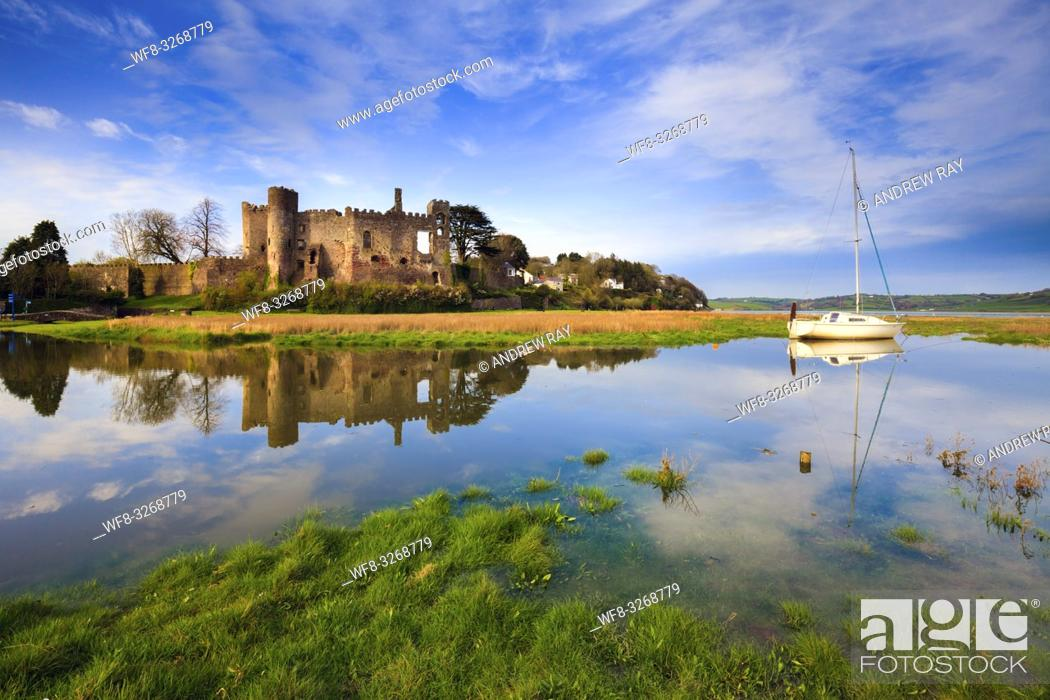 Stock Photo: The medieval castle at Laugharne in Carmathernshire, catptured at high tide on a sunny evening in mid April. Canon 5D Mark 2, Canon 16-35mm f4 L Lens at 18mm.