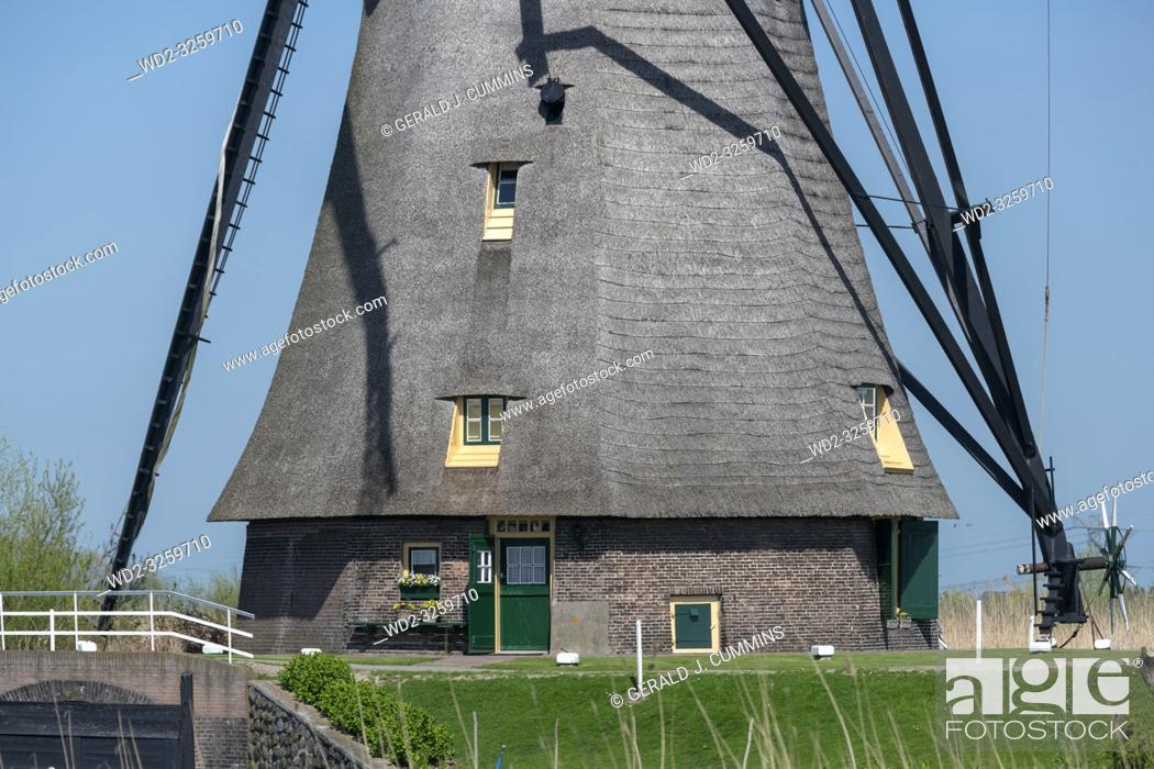Stock Photo: Netherlands, Kinderdijk, 2017, Iconic heritage site with 19 windmills from the 1700s & museum exhibits about water management.