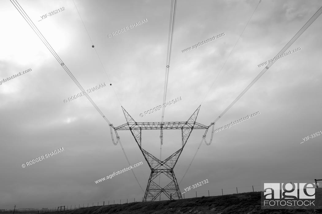 Stock Photo: Elecrical cables supported by pylons, carry power across the country. Rural South Africa.