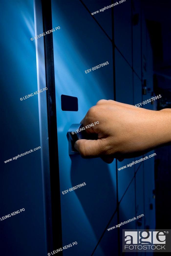 Stock Photo: thief open locker.