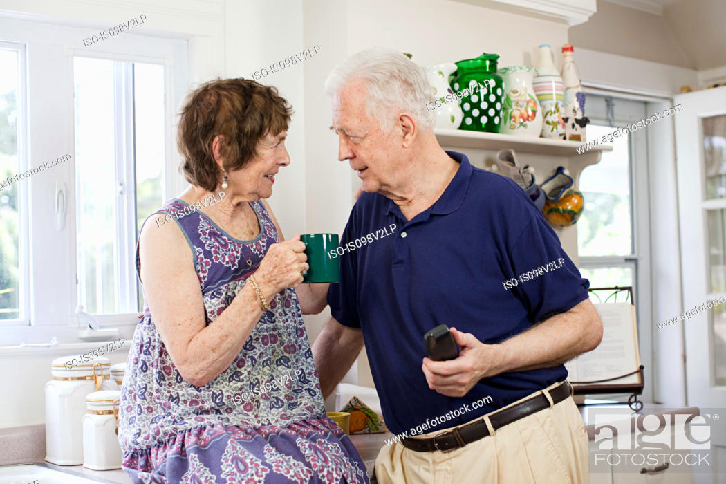 Stock Photo: Senior couple in kitchen.